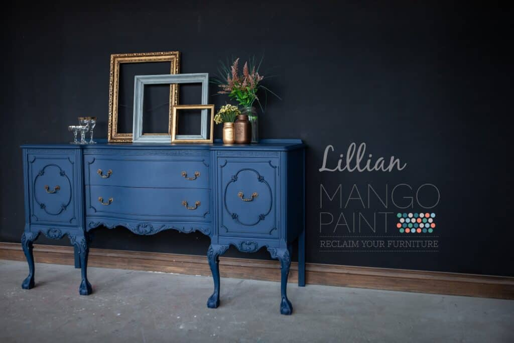 ornate dining buffet painted in Lillian dark blue Mango Paint with natural beeswax applied, angle view