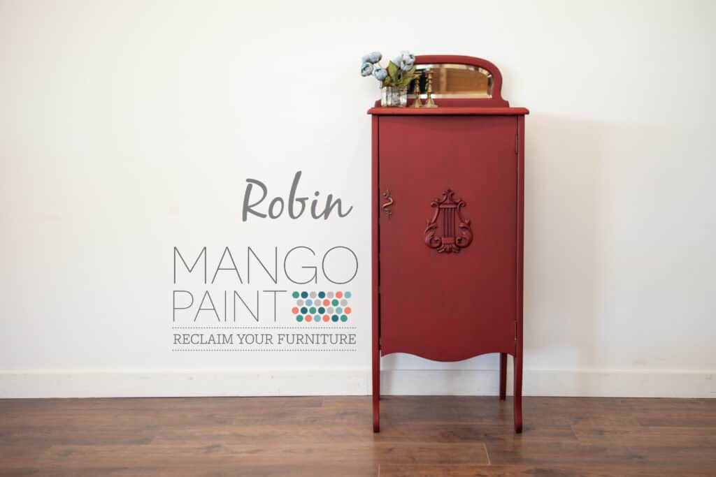 Music cabinet painted in Robin red Mango Paint with antique beeswax applied
